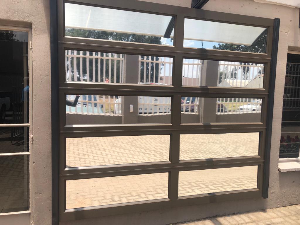 Single Glass Panel Aluminium Sectional Door